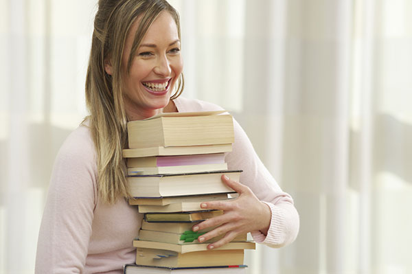 Woman Carrying Books
